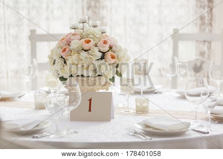 Wedding table served. Vase with Flowers
