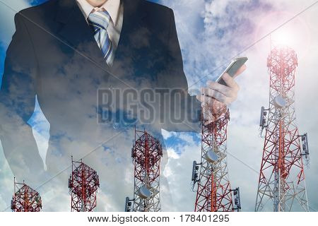 Businessman Working Smart Phone, With Double Exposure Blue Sky And Telecommunication Towers