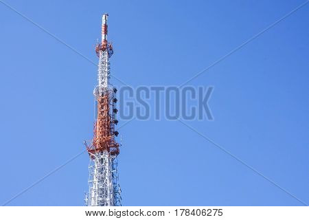 antenna tower with clear deep blue sky