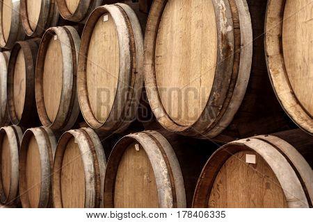 Wooden Wine Barrels In Cellar