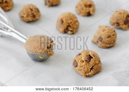 chocolate chip cookie dough with ice cream scoop