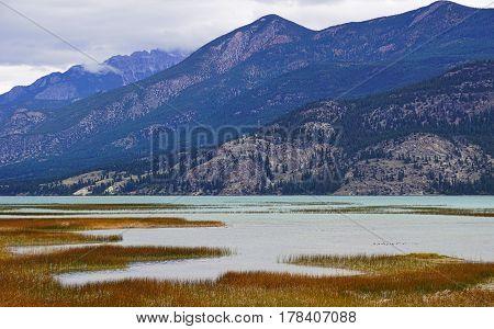 Wetlands marsh and mountain range in Autumn
