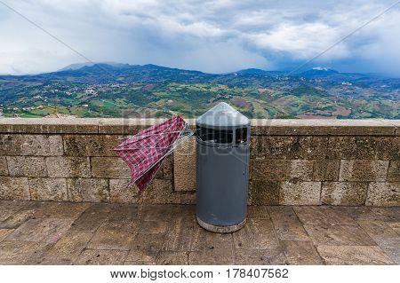 Broken Umbrella In A Rubbish Bin