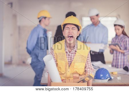 woman fired from job walking and angry over teamwork in construction site building