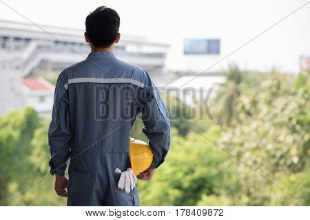 Back view of engineer looking at green nature Engineering and Eco energy save earth concept
