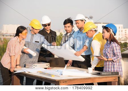 Group of engineers and architects discuss at a construction site Architecture and Engineering concept