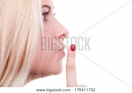 Attractive Blonde Woman Making Silence Gesture