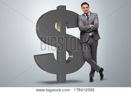 Businessman next to dollar sign
