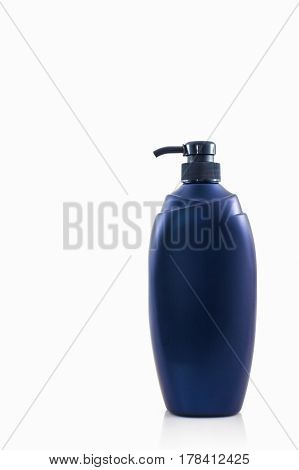 Dark blue bottle on a white background for shampoo of washing of the head and hair hygiene and health of hair.