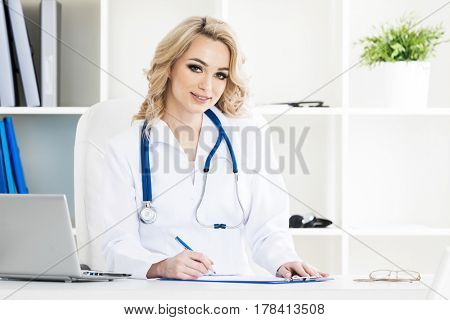 Portrait of smiling beautiful female doctor in a clinical office