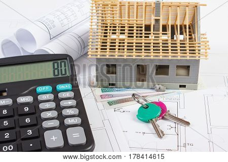 House Under Construction, Keys, Calculator, Polish Currency And Electrical Drawings, Concept Of Buil