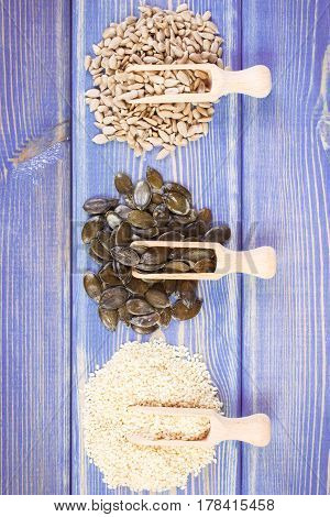 Sunflower, Pumpkin And Sesame Seeds On Wooden Boards, Healthy Nutrition Concept