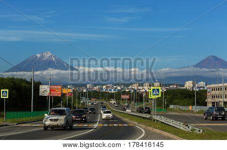 Petropavlovsk-Kamchatsky, Russia - August 13, 2016: Petropavlovsk-Kamchatsky city on the background of Koryaksky and Avachinsky volcanoes