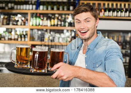Man serving beers in a bar