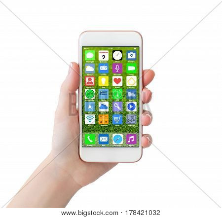 isolated woman hand holding white phone with home screen icons apps