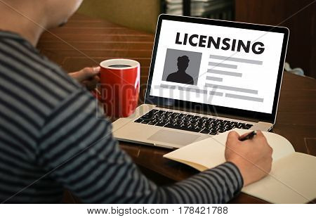 Patent License Agreement Licensing   Business Man Hand Working On Laptop Computer