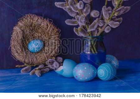 Blue Easter Egg In The Nest  And  Branch Of A Willow