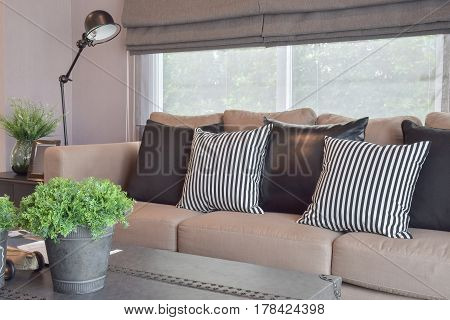 Freshen Stuff On The Table With Striped And Black Leather Pillows In A Modern Industrial Style Livin