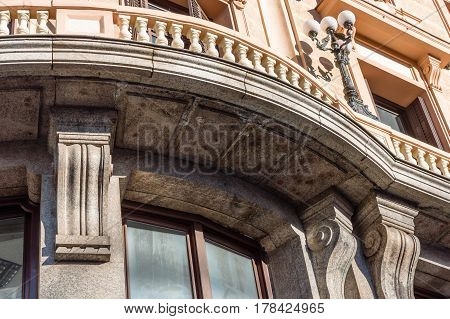 Madrid Spain - September 18 2016: Low angle view of buildings at Gran Via Street in Madrid. It is an important street in Central Madrid with shops and theaters.