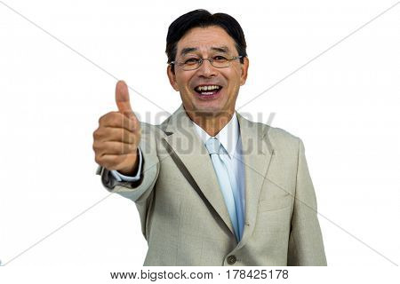 Happy businessman smiling with thumbs up