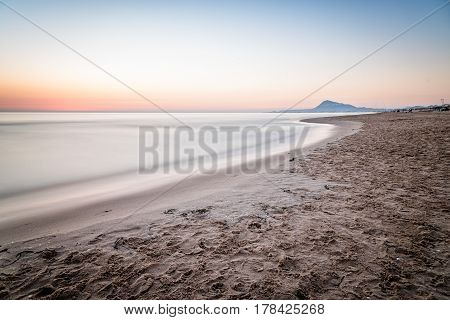 Scenic View Of Sea Against Sky At Morning in Oliva Valencia Spain. Long exposure shot blurred motion
