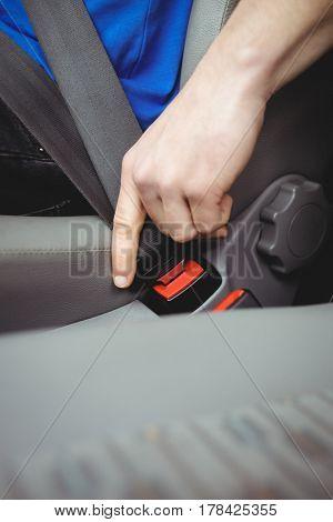 Man buckling his seatbelt in a van