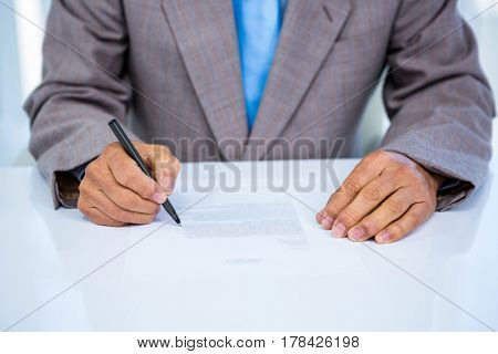 Serious businessman making notes in office