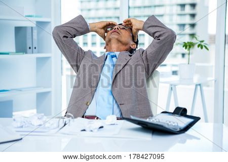 Worried businessman working at his desk in office