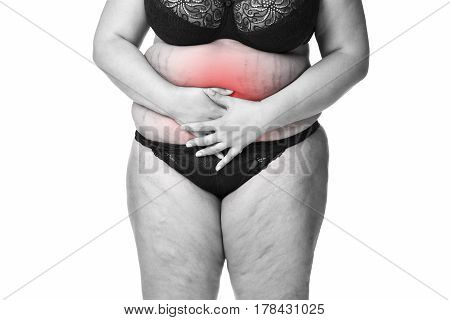 Fat woman with menstrual pain endometriosis or cystitis stomach ache overweight female body isolated on white background black and white photo with red spots