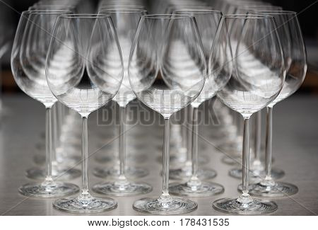 row of empty wine glasses closeup with focus on foreground