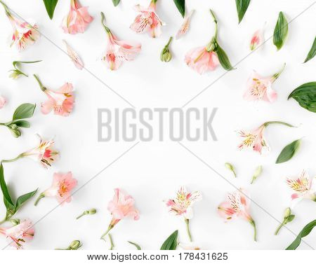 flat lay frame with alstroemeria leaves and petals on white background. top view