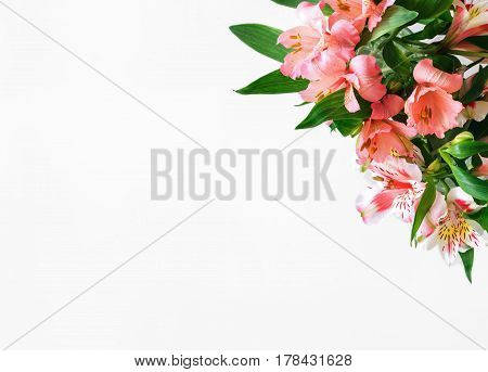 Bouquet of flowers alstroemeria on white background with copy space. top view