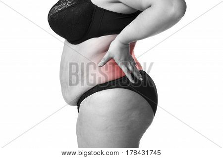 Back pain fat woman with backache overweight female body isolated on white background black and white photo with red spots side view