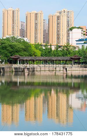 Residential Buildings Reflecting In The Water In Chengdu - China