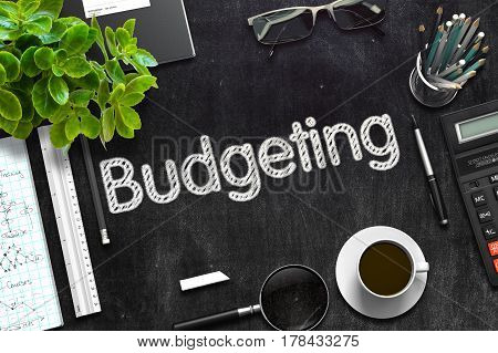 Budgeting. Business Concept Handwritten on Black Chalkboard. Top View Composition with Chalkboard and Office Supplies. 3d Rendering. Toned Illustration.