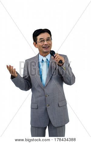 Asian businessman holding microphone on white background