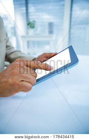 Focused businessman using tablet in office