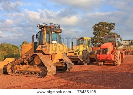 Bulldozer and rollers on a road construction site