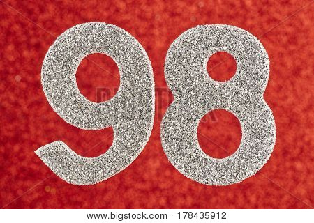 Number ninety-eight silver color over a red background. Anniversary. Horizontal
