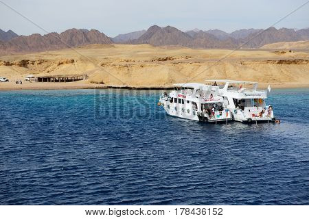 SHARM EL SHEIKH EGYPT - DECEMBER 4: Snorkeling tourists and motor yachts on Red Sea in Ras Muhammad National Park. It is popular tourists destination on December 4 2013 in Sharm el Sheikh Egypt