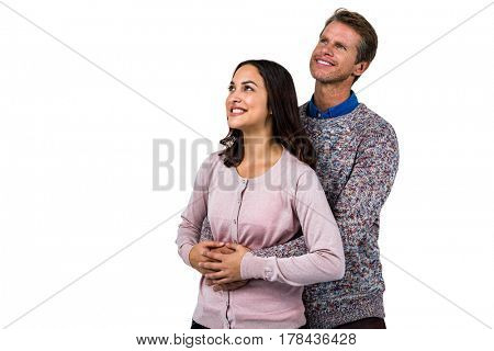 Close-up of smiling man and woman against white background