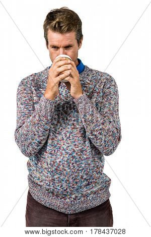 Close-up of man drinking coffee against white background