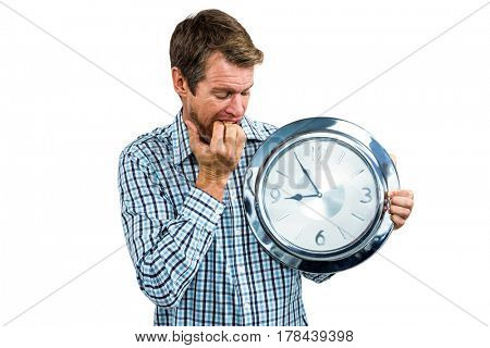 Anxious late man holding a clock on white background