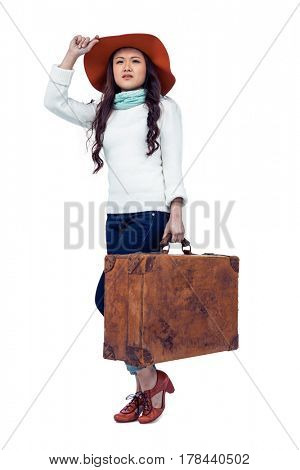 Asian woman with hat holding luggage on white screen