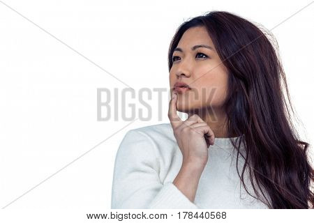 Thoughtful Asian woman with finger on chin on white screen