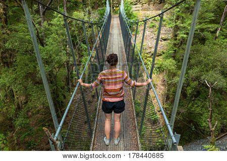 Woman on a suspension bridge