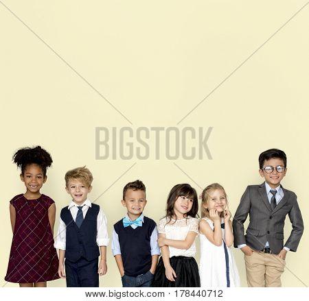 Little Children Dressed Up Smiling