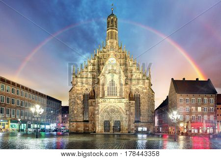 Nuremberg cathedral Frauenkirche in Hauptmarkt wtih rainbow Bavaria Germany