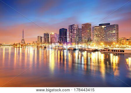 Skyline of Paris at night with seine