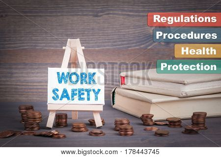 Work Safety Business Concept. Miniature easel with small change.